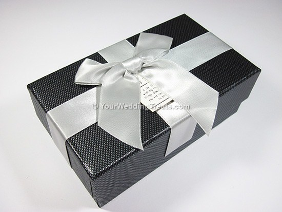 black cardboard favor box with ribbon message