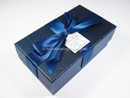 blue cardboard favor box with ribbon message
