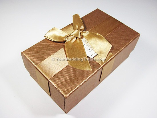 gold cardboard favor box with ribbon message