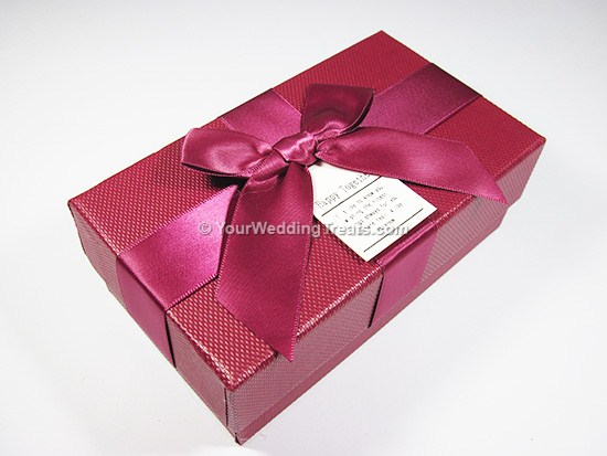maroon cardboard favor box with ribbon message