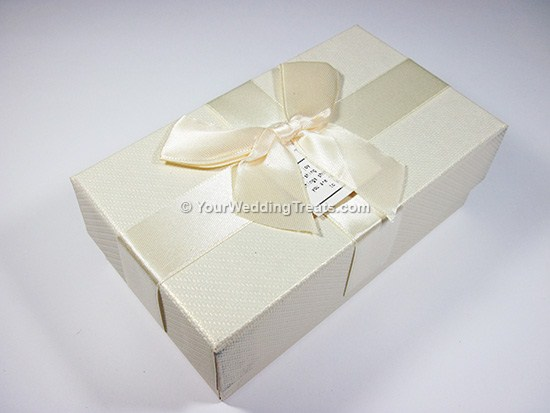 white cardboard favor box with ribbon message