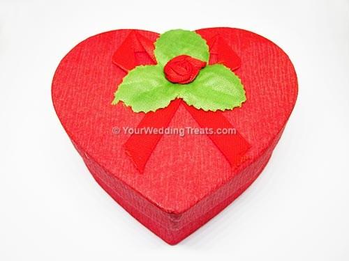red heart shaped cardboard favor box