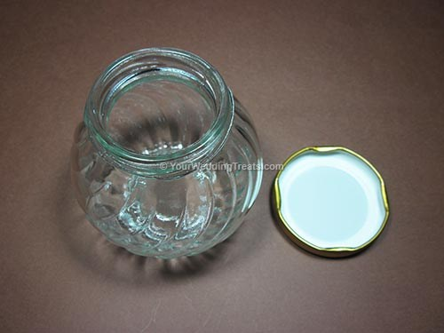 glass jar wedding favor with gold colored cover
